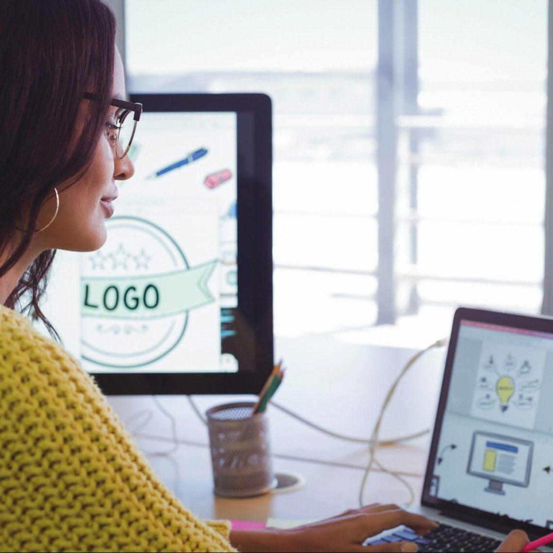 Female graphic designer working in office
